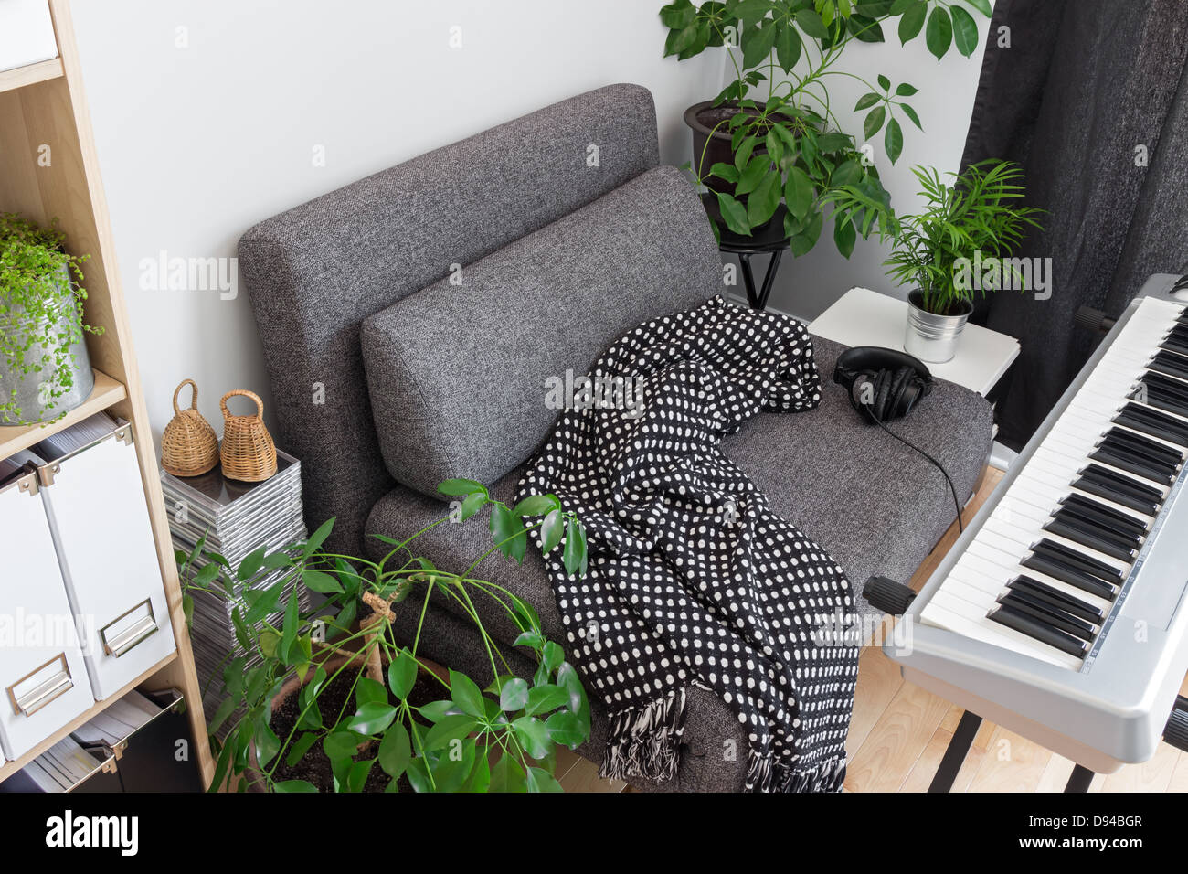 Comfortable place for a musician. Armchair and electric piano. - Stock Image