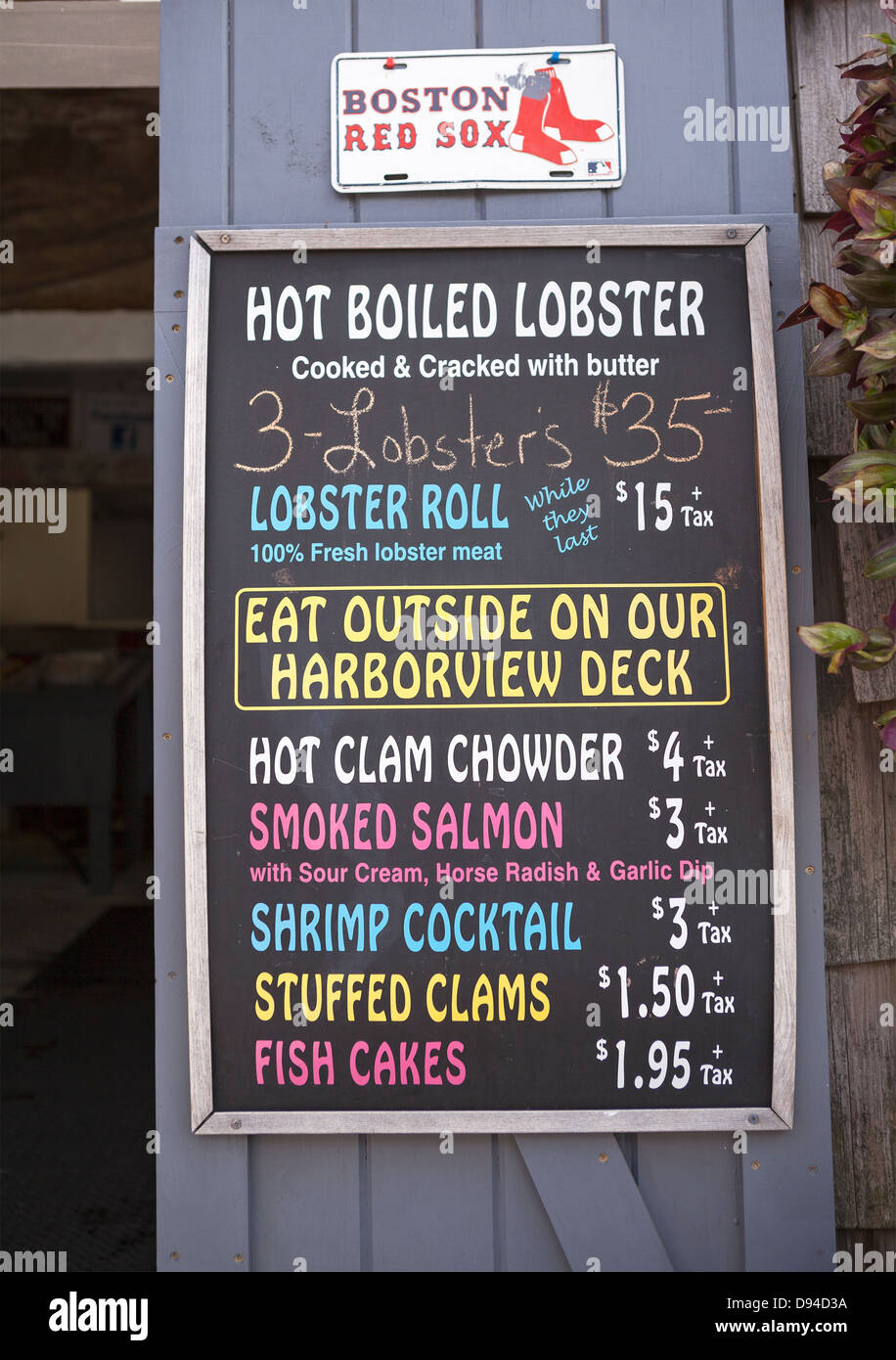 A menu at a seafood shanty lists the local specialties. - Stock Image