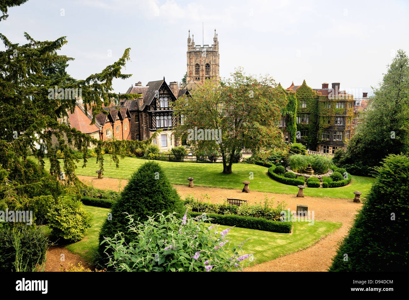 Great Malvern, Worcestershire, England. The tower of the Priory Church of St. Mary and St. Michael rises behind - Stock Image