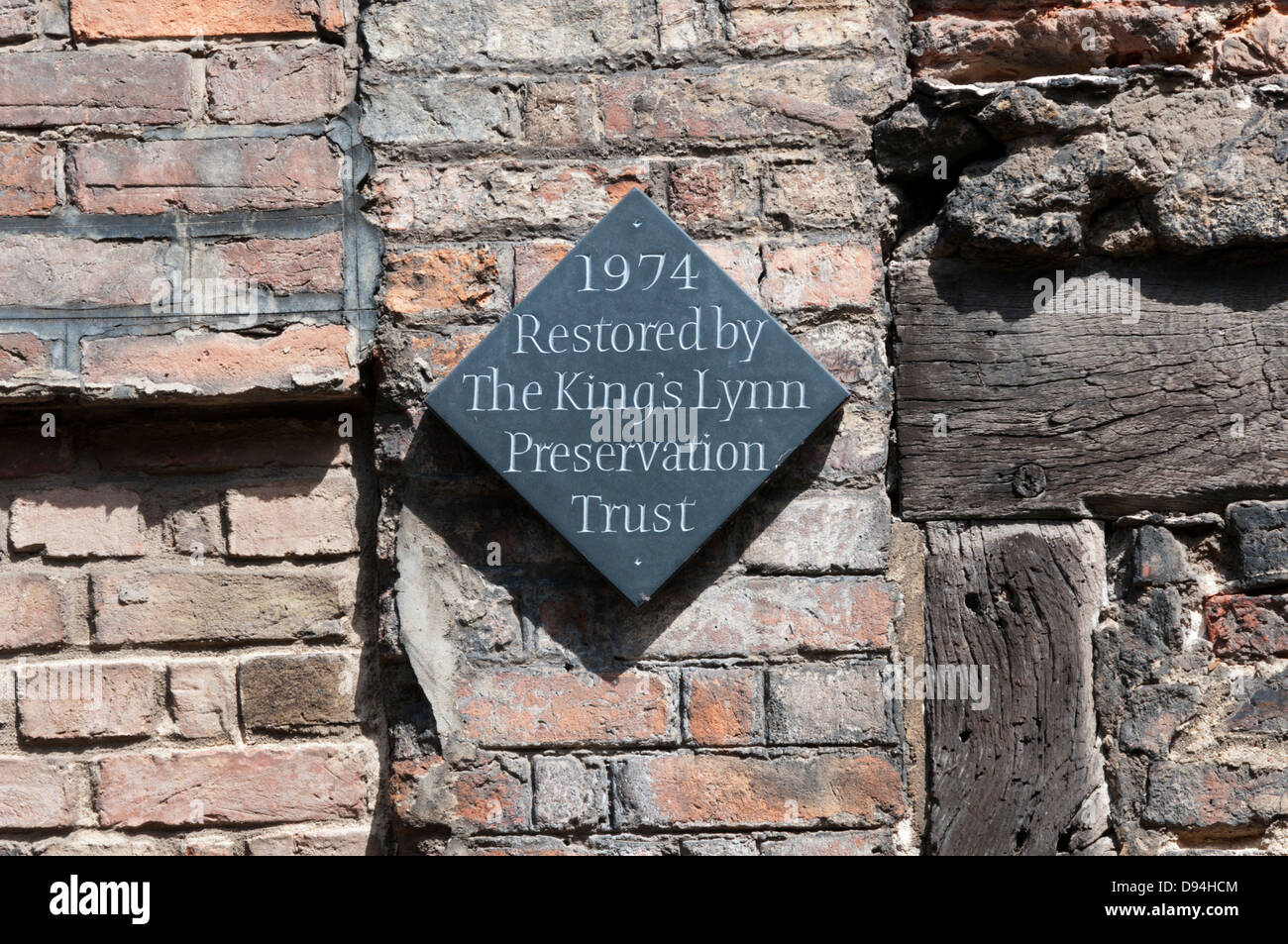 A plaque records a building restored by the King's Lynn Preservation Trust. - Stock Image
