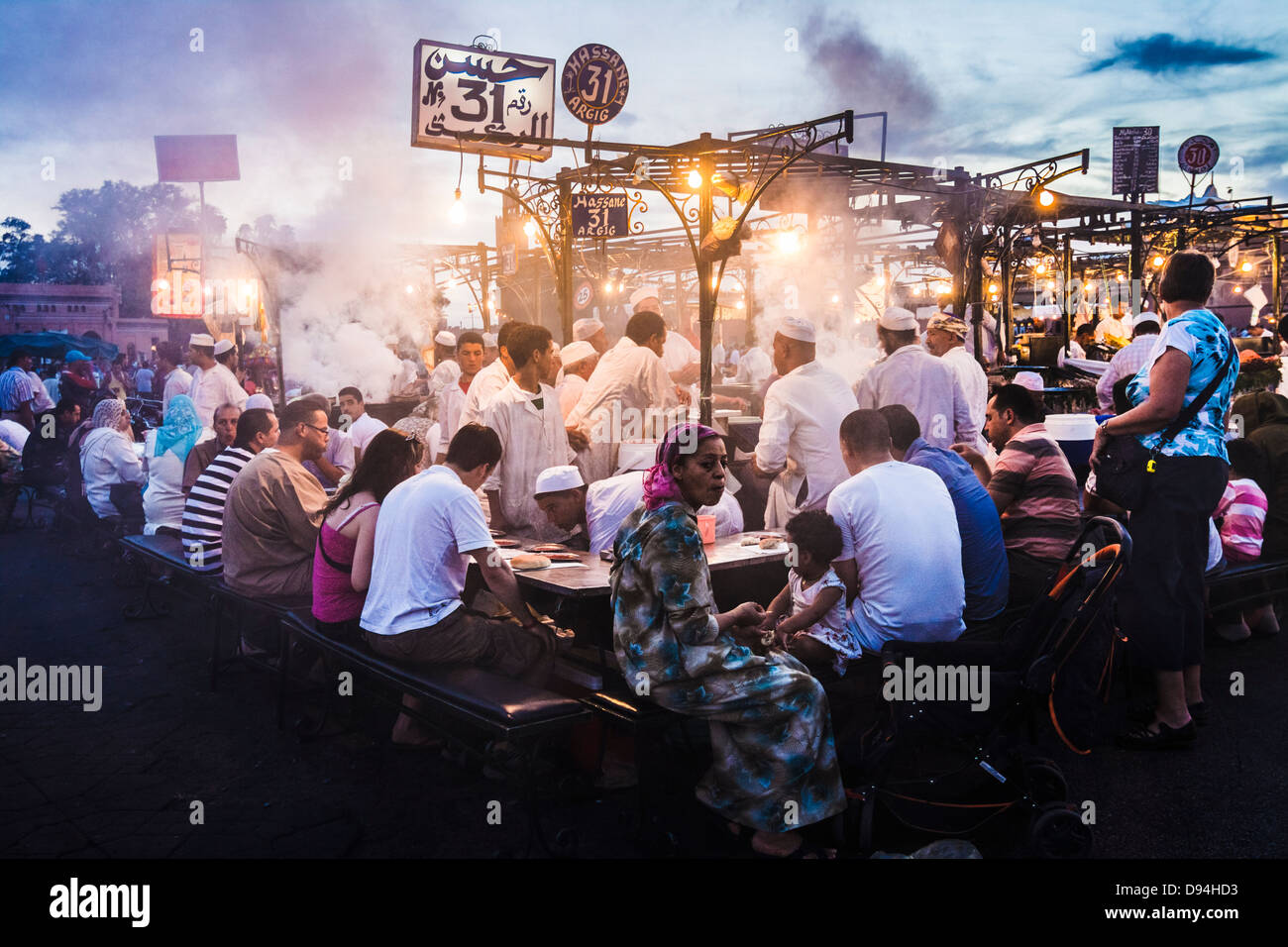 Djemaa el Fna square. People dining at the food stalls at dusk. Marrakesh, Morocco - Stock Image