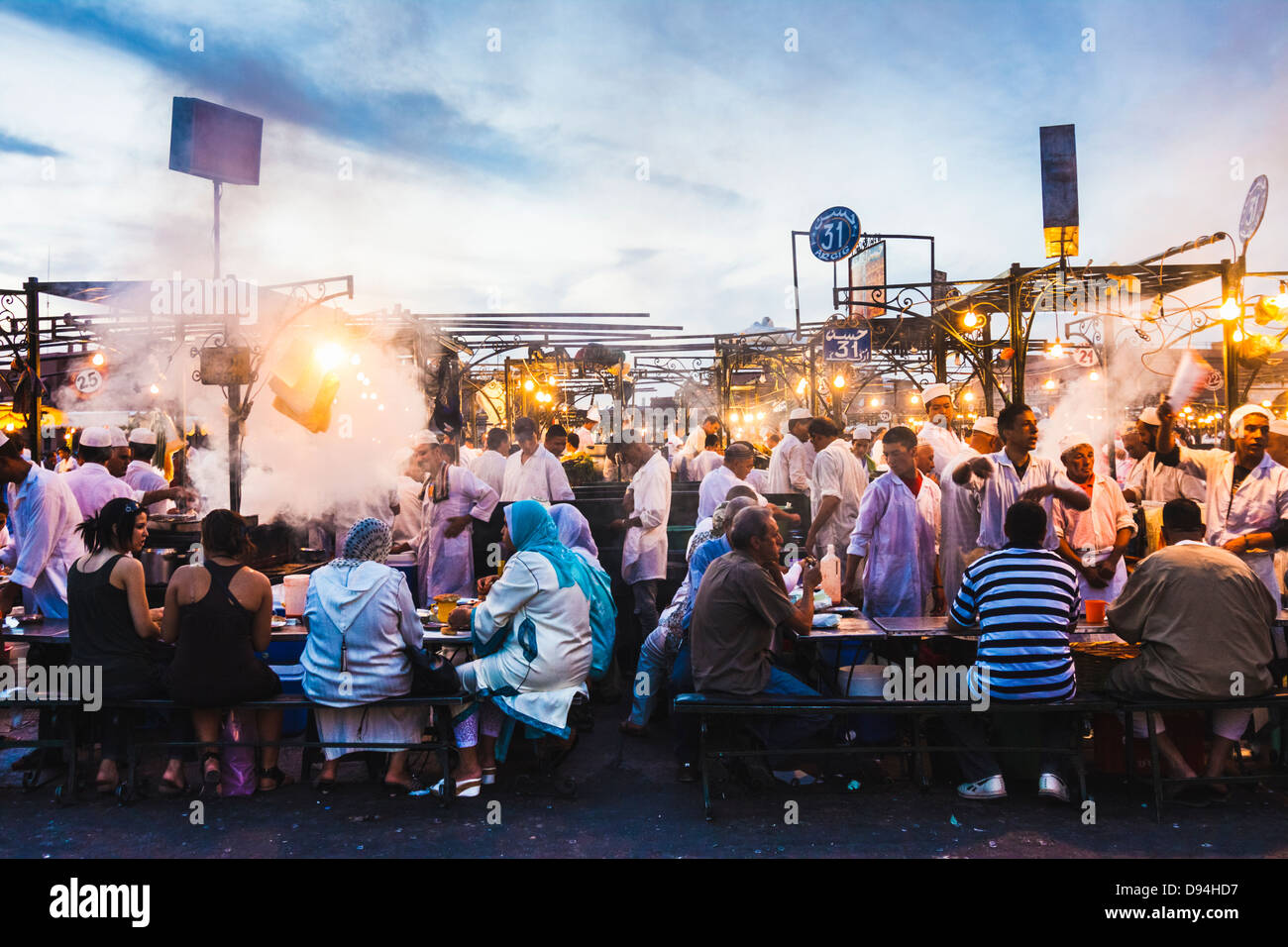 Djemaa el Fna square. People dining at the food stalls at dusk. Marrakesh, Morocco Stock Photo