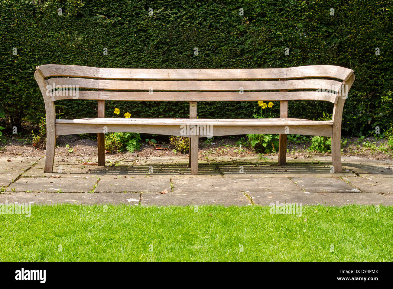 Empty wooden bench in English country garden Stock Photo