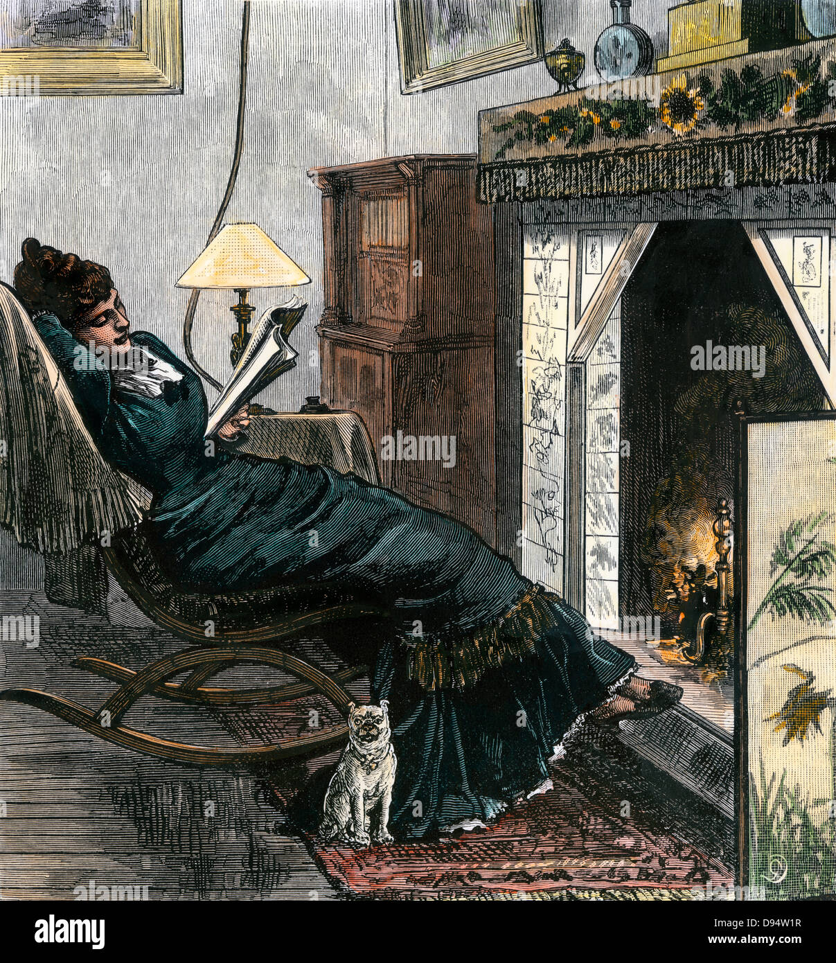 Woman reading by the fire in the Victorian era. Hand-colored woodcut - Stock Image