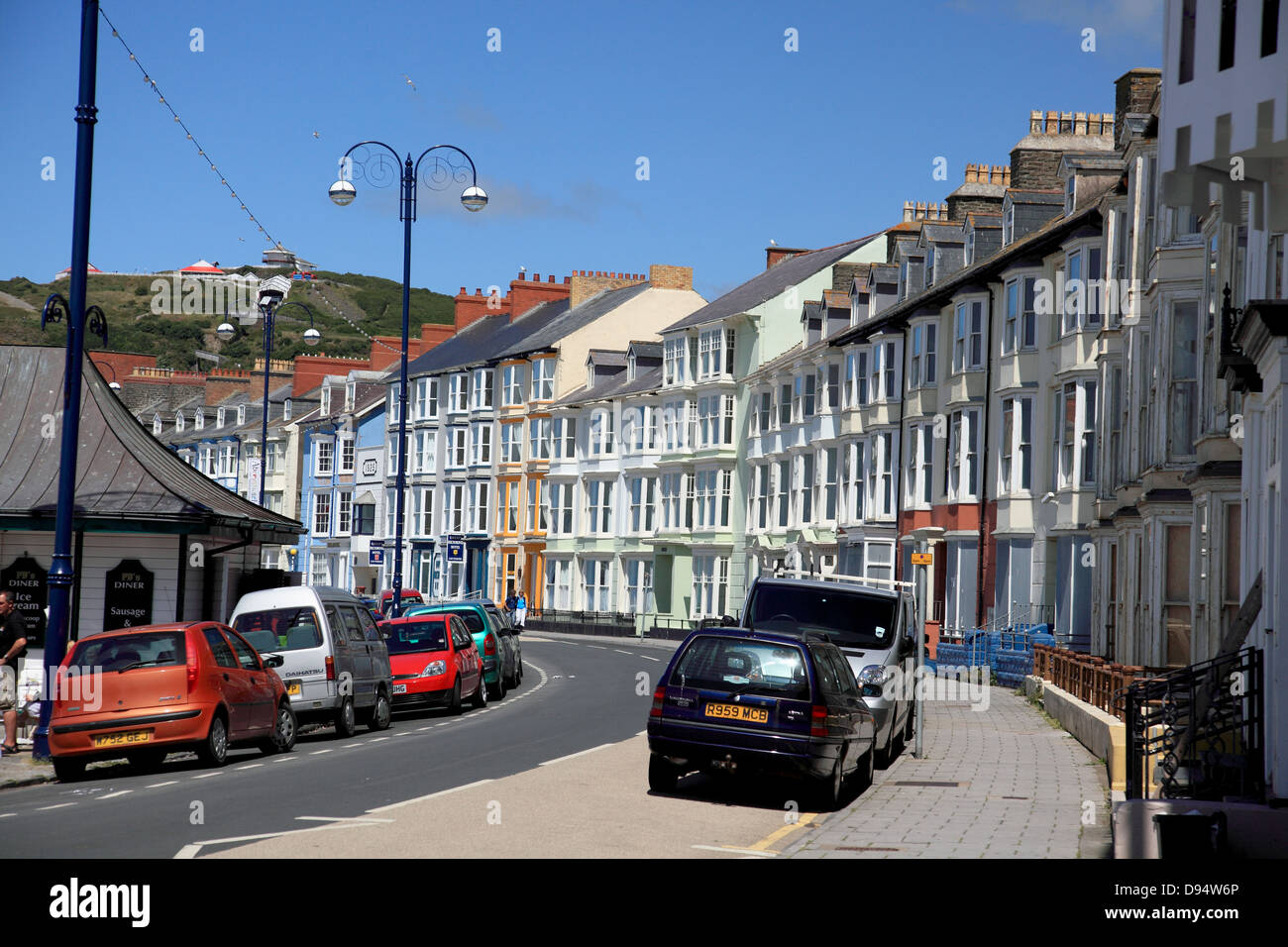 Guest Houses and hotels on Marine Terrace next to the seafront promenade at Aberystwyth on the west coast of Wales - Stock Image