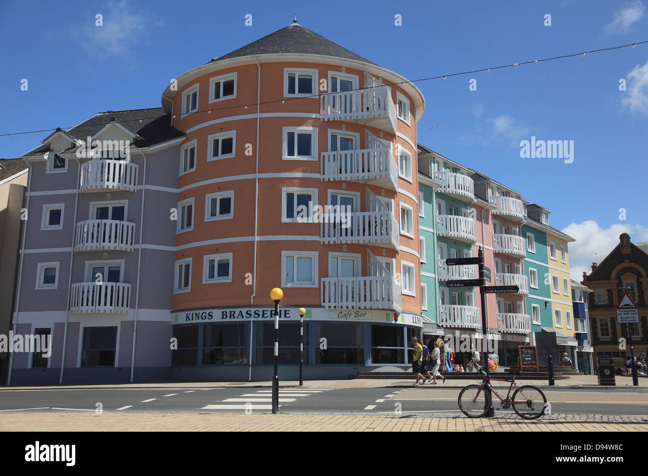 Brasserie and shops at Llys Y Brenin square next to the seafront promenade at Aberystwyth on the west coast of Wales - Stock Image
