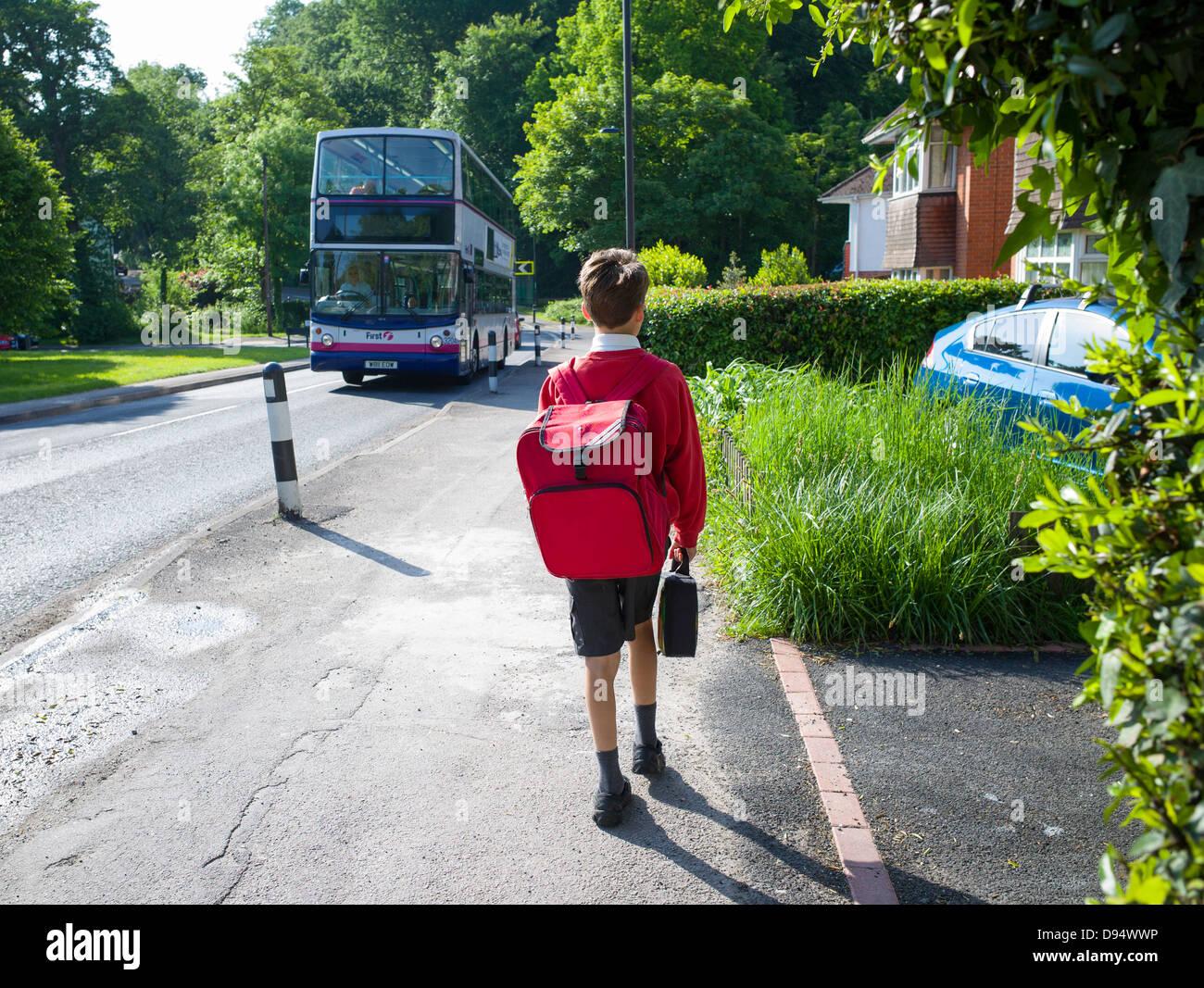 one young boy walks to school - Stock Image
