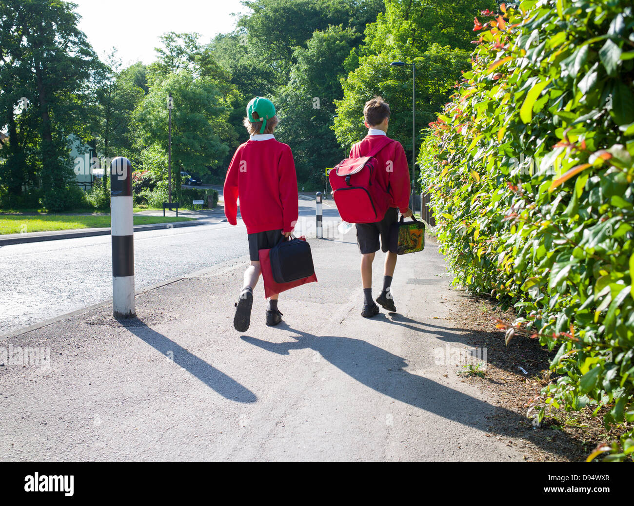 two young boys walk to school - Stock Image