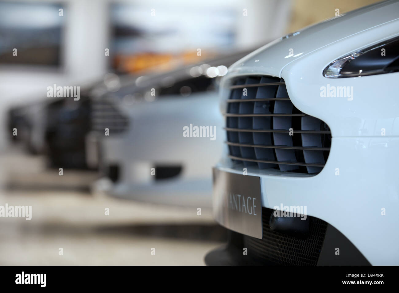 Aston Martin cars in a new car showroom in Leeds - Stock Image