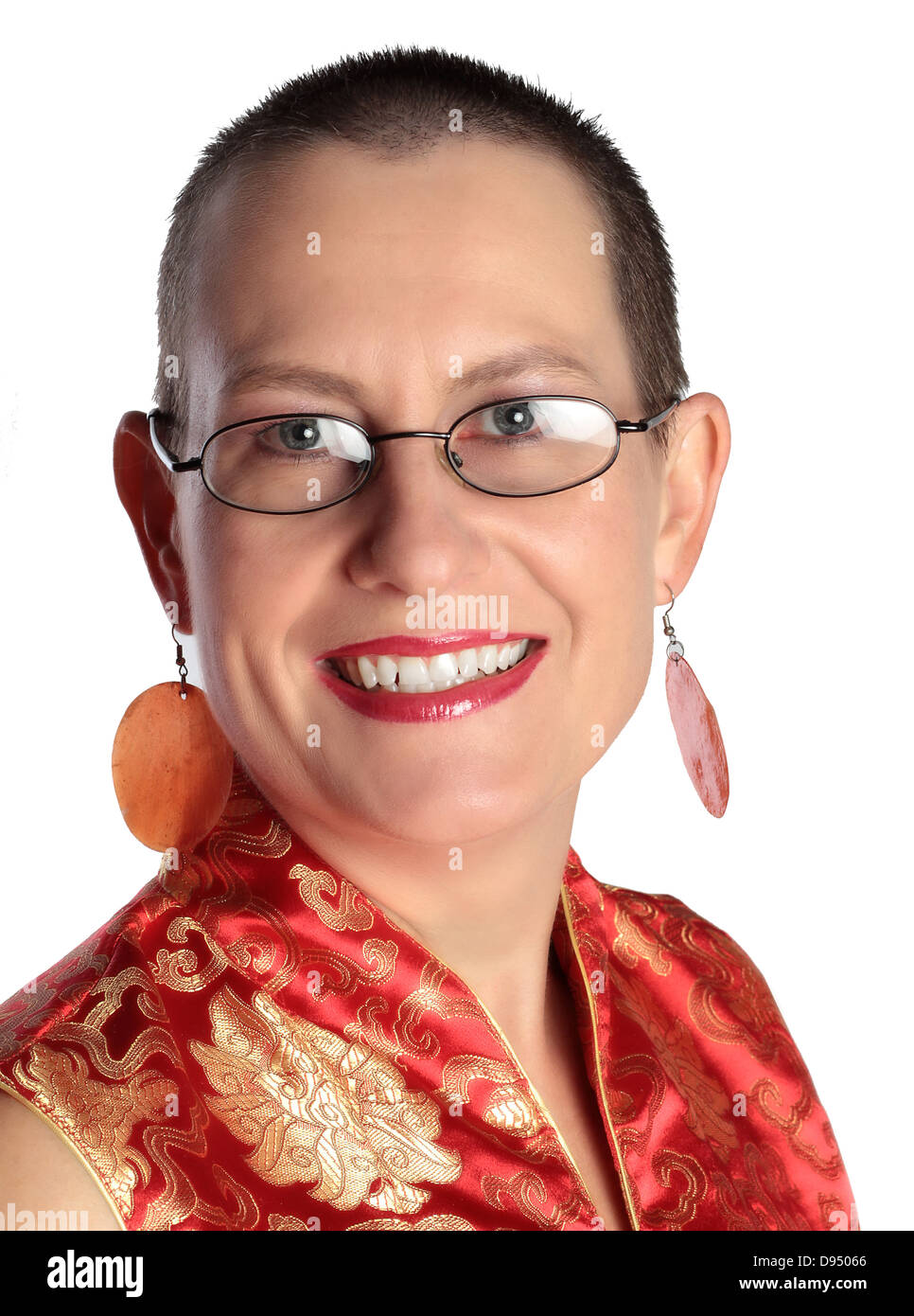 a beautiful late thirty's mom wearing glasses is smiling at the camera. she has a very short hair cut. Stock Photo