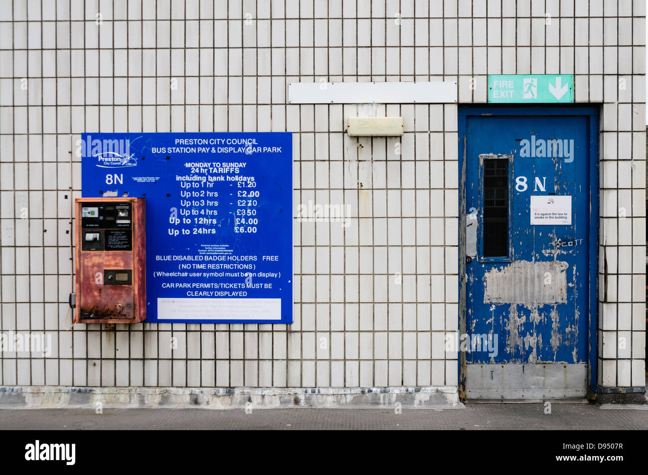 Ticket machine, price list, and a tatty door at Preston Bus Station multi storey car park - Stock Image