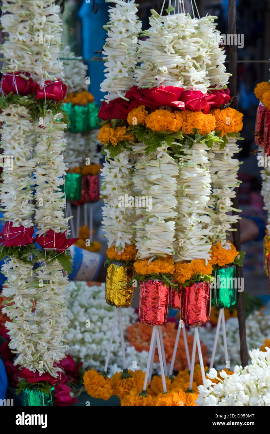 Asia, India, Karnataka, Belur, flower garlands outside a Hindu temple - Stock Image