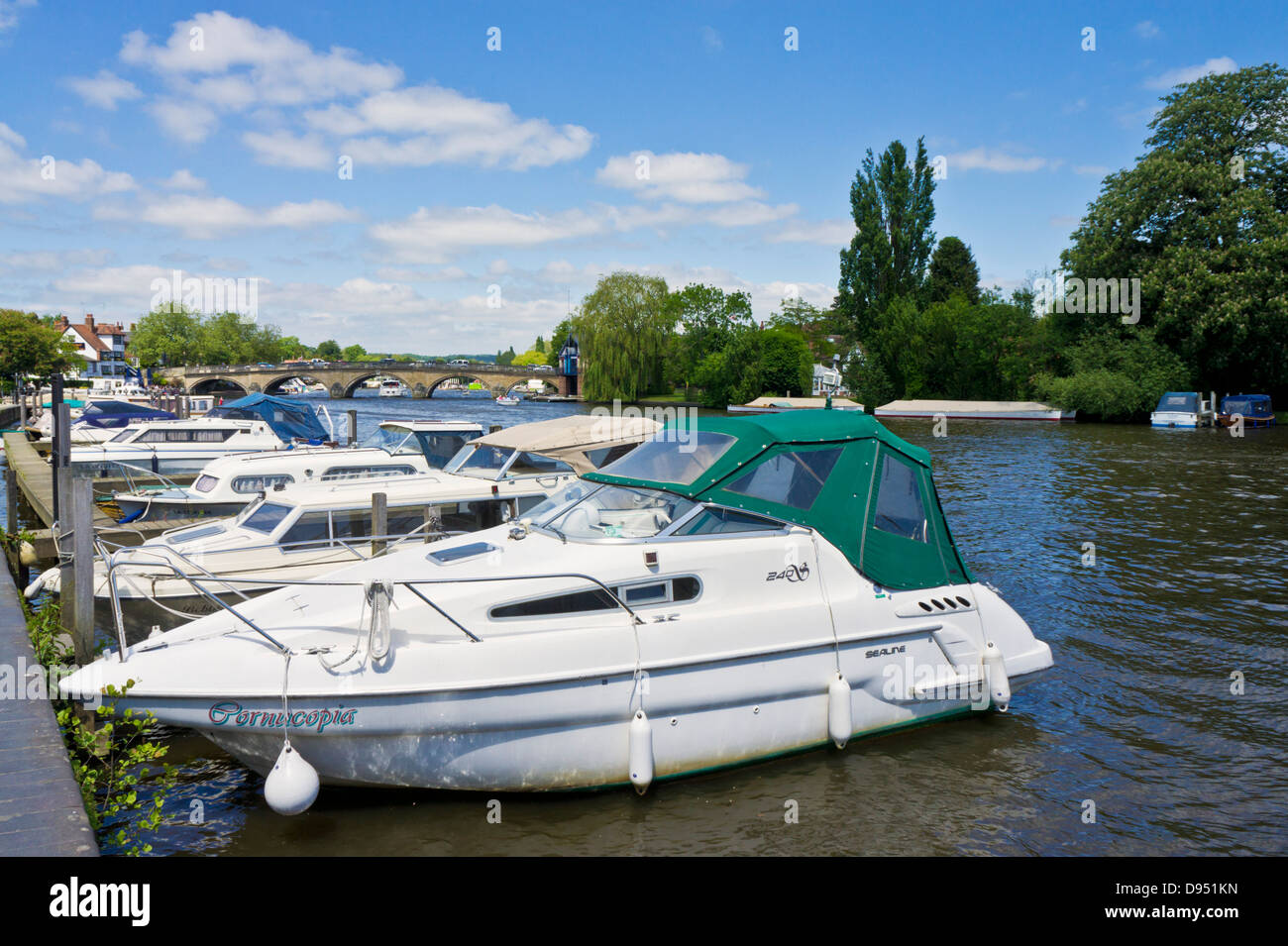 Motorboats moored by the side of the river Thames at Henley-on-Thames Oxfordshire England UK GB EU Europe - Stock Image