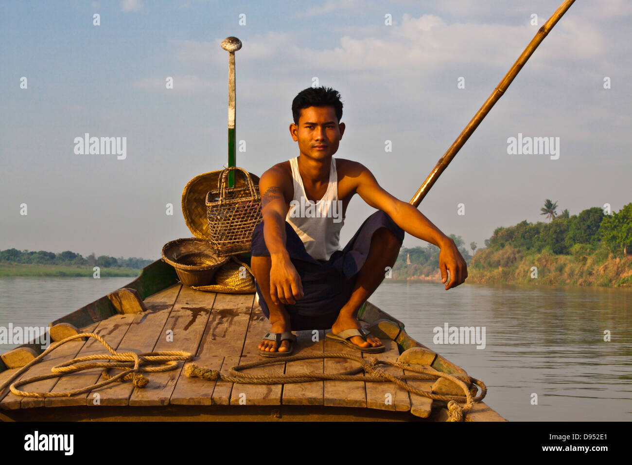 A BOATMAN on the way to INWA which served as the Burmese Kingdoms capital for 400 years - MYANMAR - Stock Image