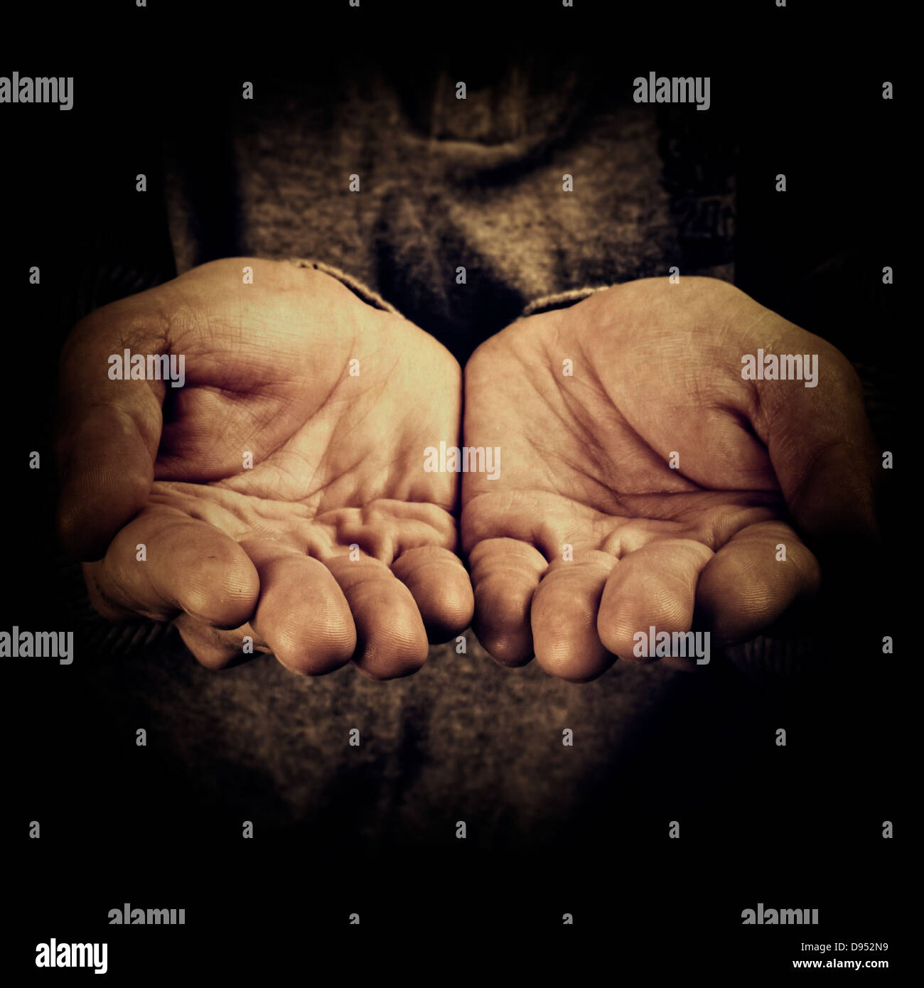 High contrast image of a person begging - Stock Image