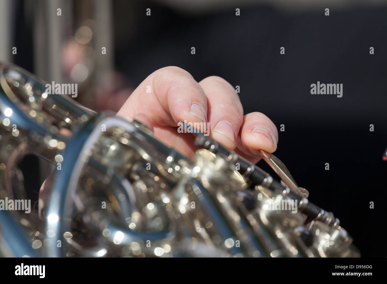 extreme close up of fingering of french horn - Stock Image