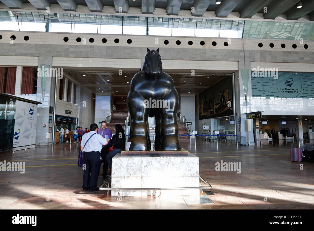 black horse sculpture by botero in barcelona el prat airport terminal 2 catalonia spain - Stock Image