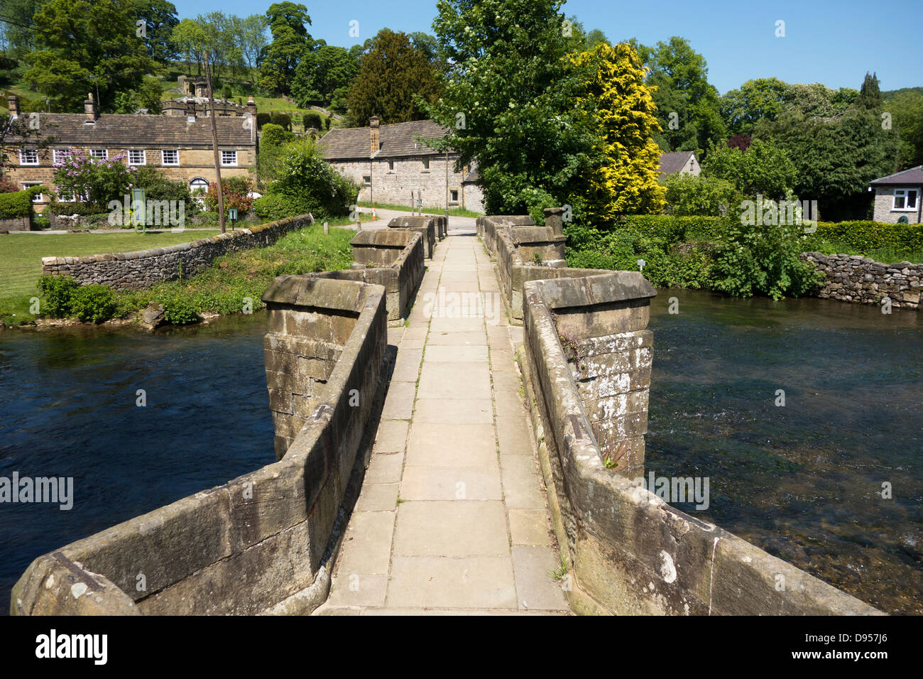 Holme Bridge a packhorse bridge built in 1664 on the River Wye at Bakewell, Derbyshire, England, U.K. - Stock Image