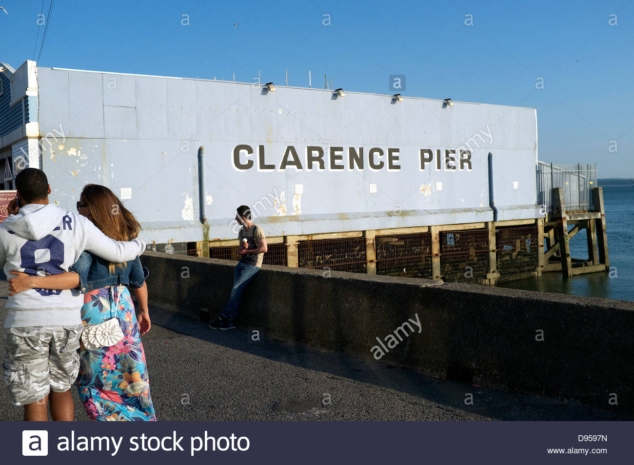 People relax by Clarence Pier on Southsea seafront, Portsmouth, Hampshire, UK. Stock Photo