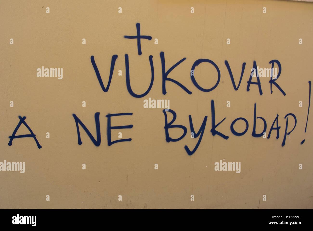 Graffiti against cirillic alphabet in Vukovar, on the wall in Zagreb city center, Croatia, Europe - Stock Image
