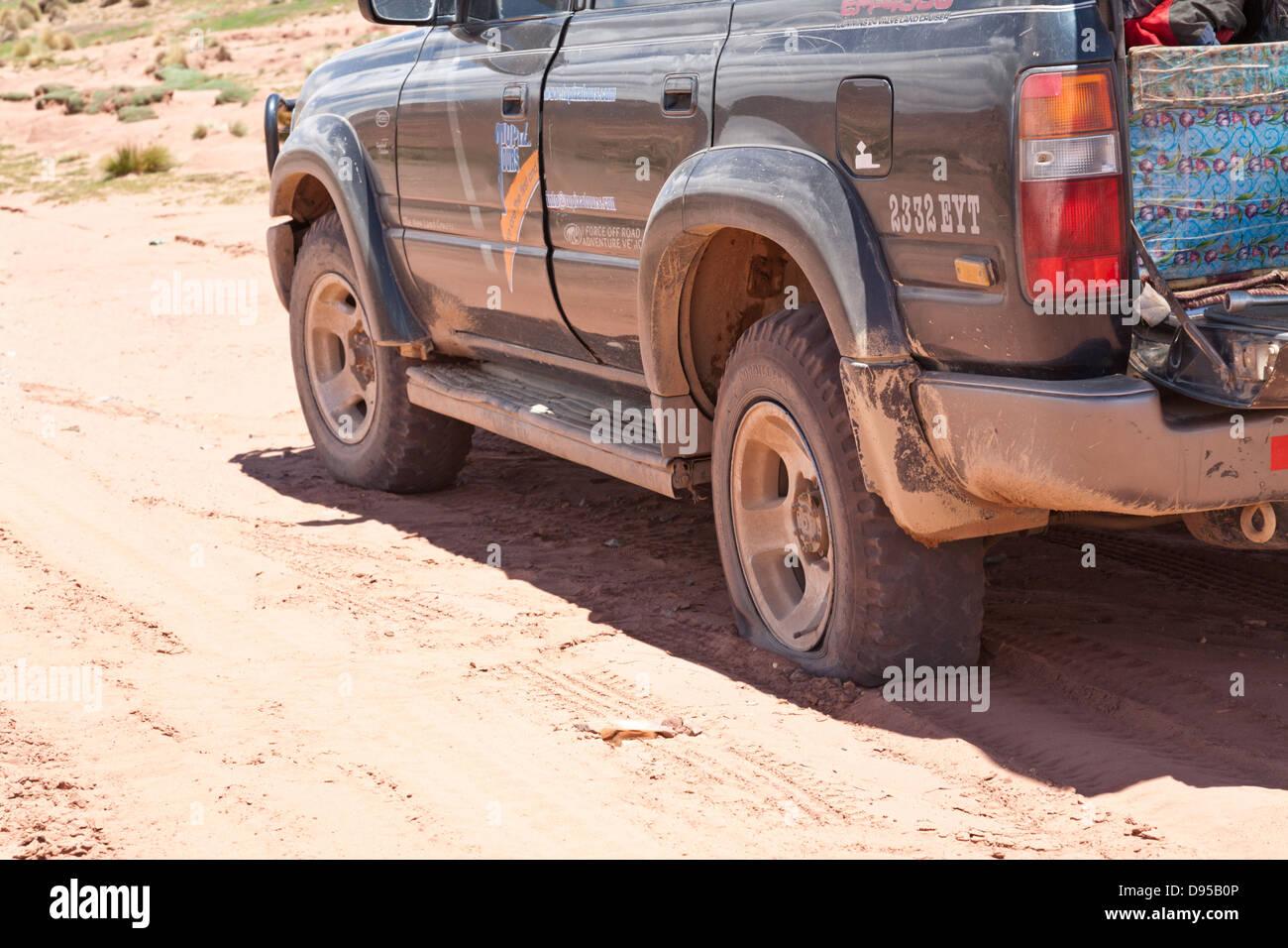 Puncture, Salt Flat Tours, Altiplano, Southwest Bolivia Stock Photo
