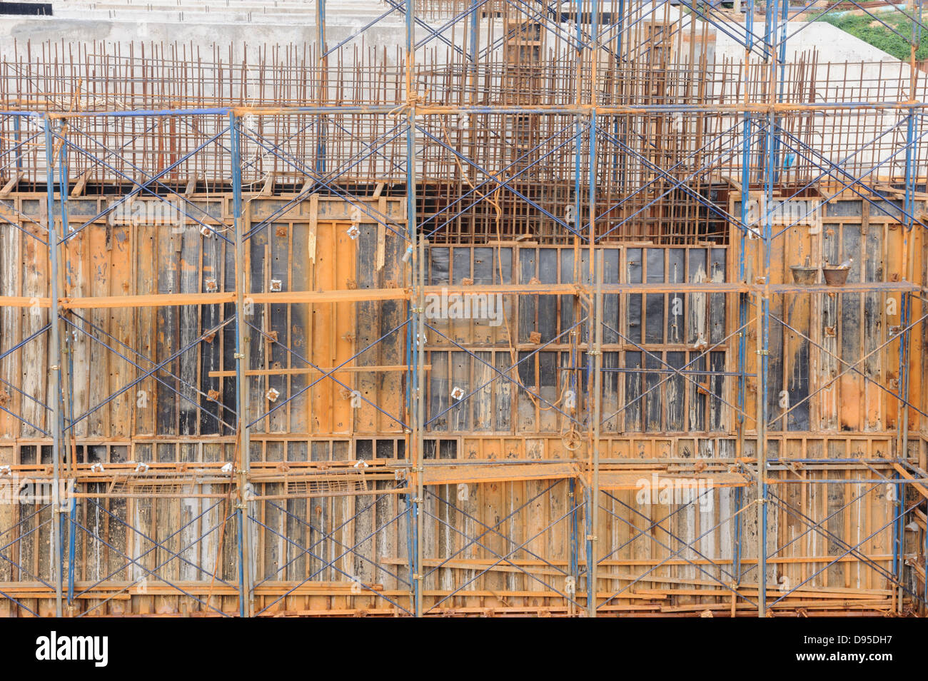 View of a metal scaffolding by work on dam construction site, Thailand. - Stock Image