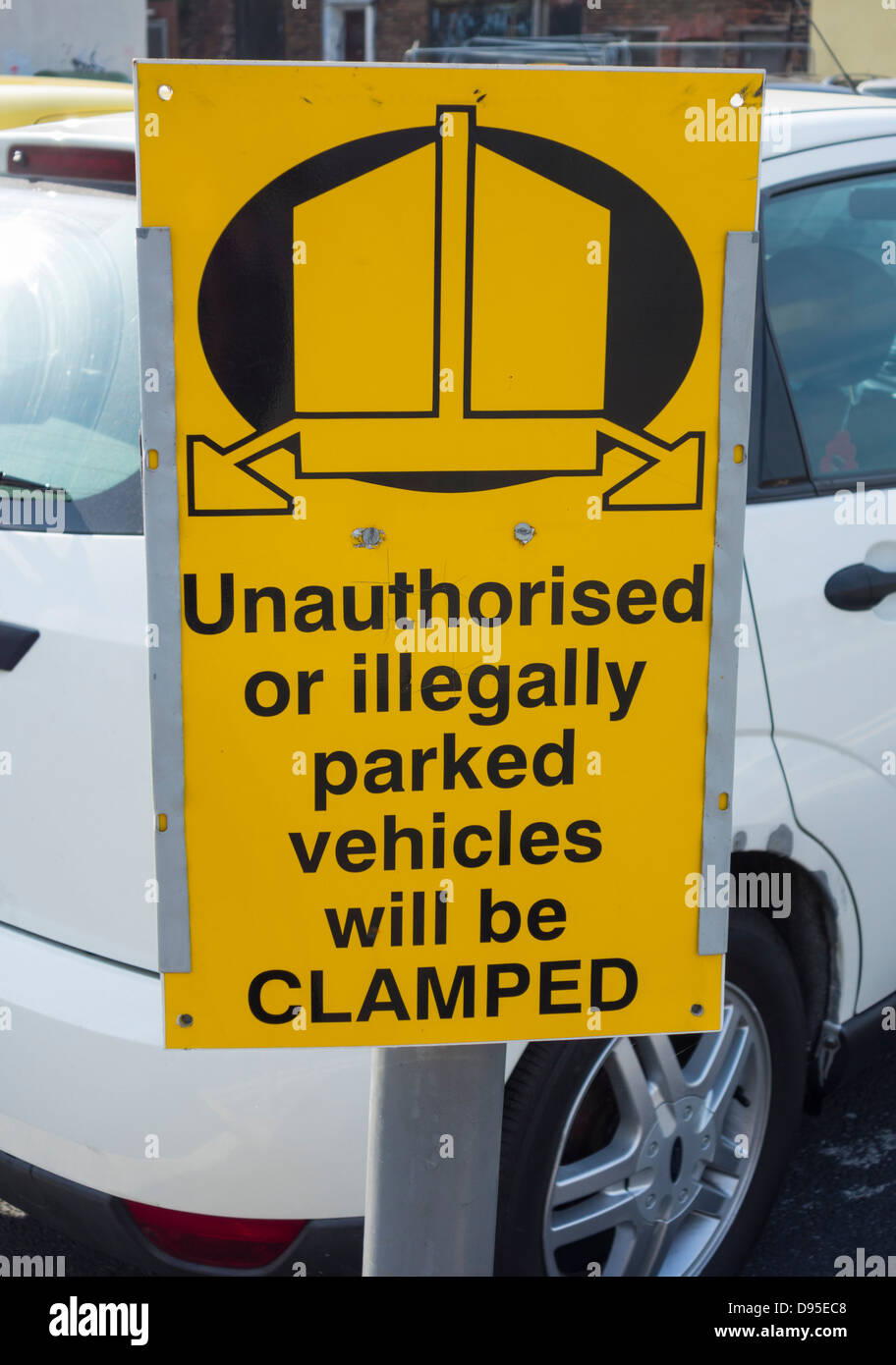 Wheel clamping sign in car park in UK - Stock Image
