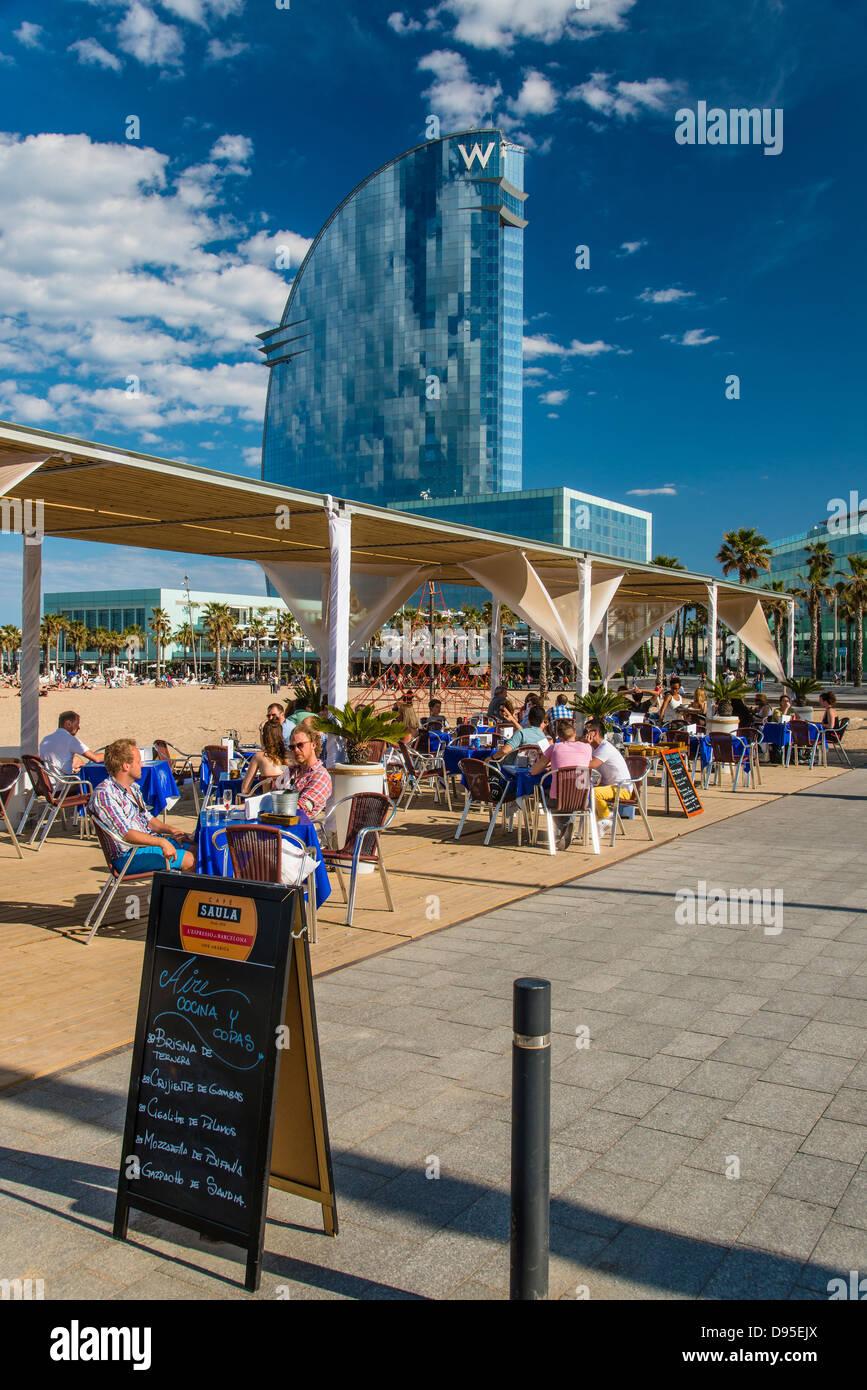 Tourist seated in a beach bar in Barceloneta, Barcelona, Catalonia, Spain - Stock Image