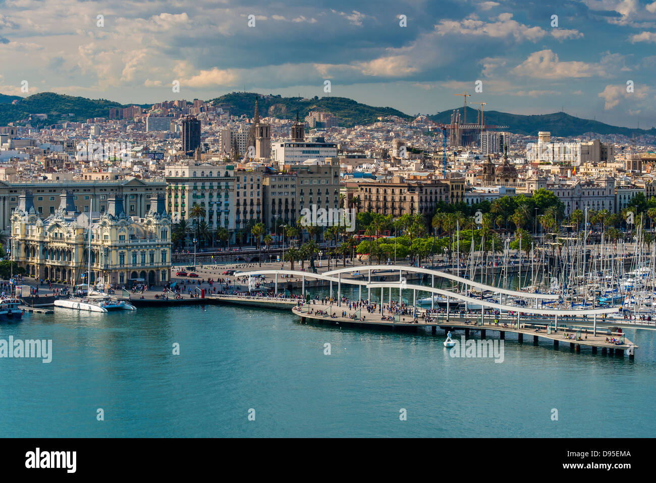 City skyline and Port Vell at sunset, Barcelona, Catalonia, Spain - Stock Image