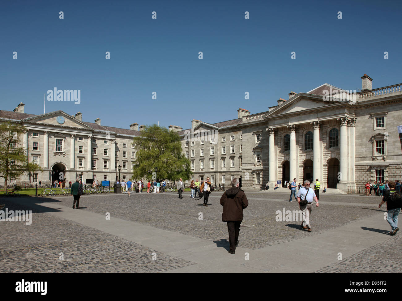 Tourists visist Trinity College Dublin Ireland - Stock Image