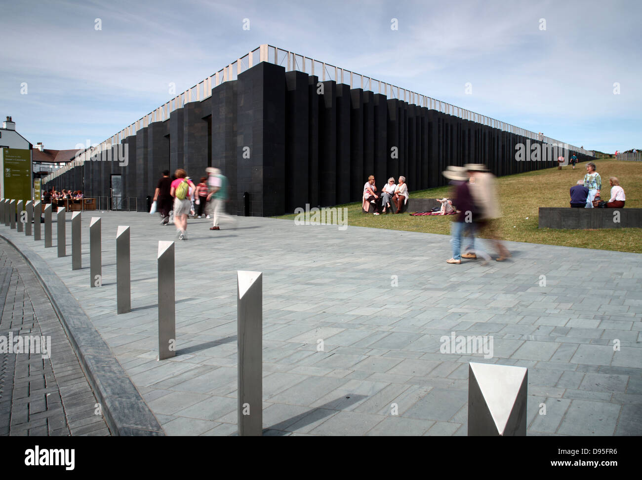 Tourists at Giants Causeway Visitor Centre - Stock Image