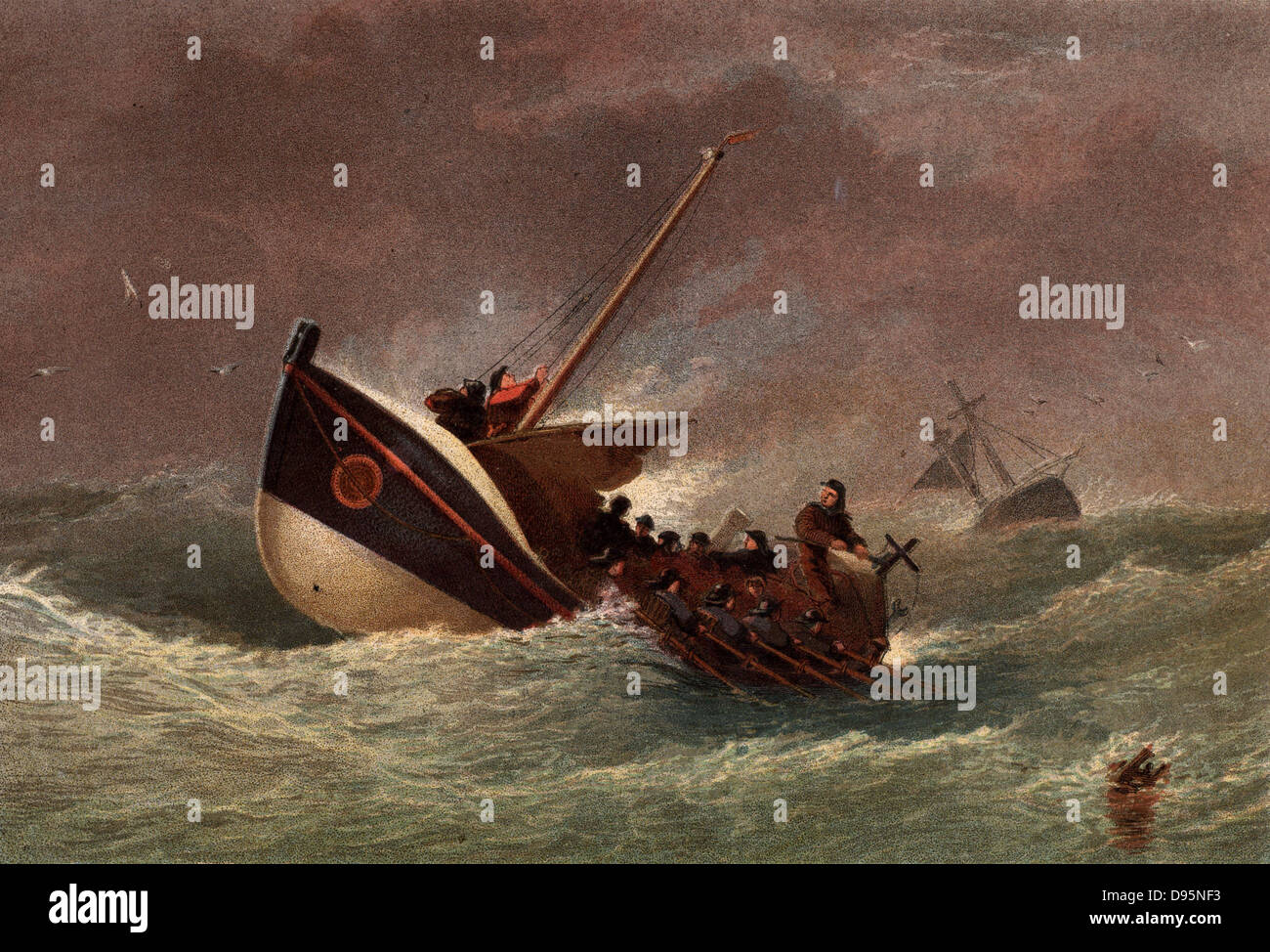 Lifeboat in the livery of the Royal National Lifeboat Institution in heavy seas returning from a rescue mission. - Stock Image