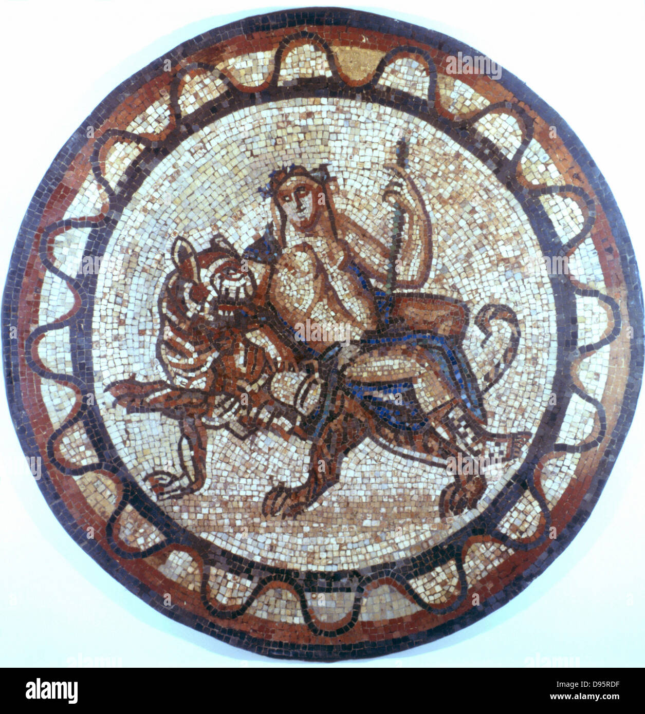 Bacchus, Ancient Roman god of Wine (Dionysius in Greek pantheon) riding on a tiger. Roman mosaic of 1st or 2nd century - Stock Image