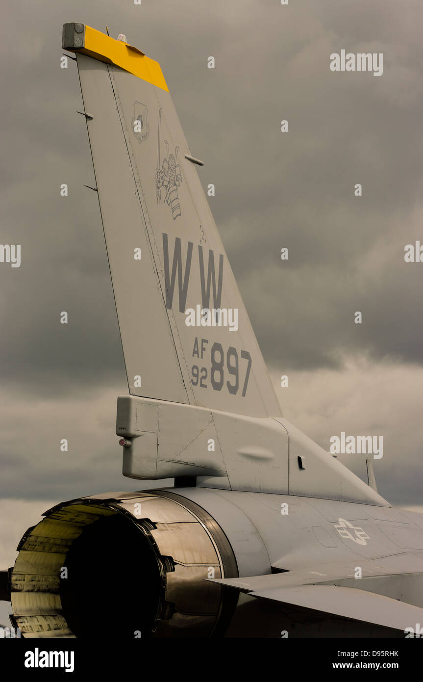 A close up of the tail plane and exhaust nozzle of a USAF F-16 fighter jet. - Stock Image