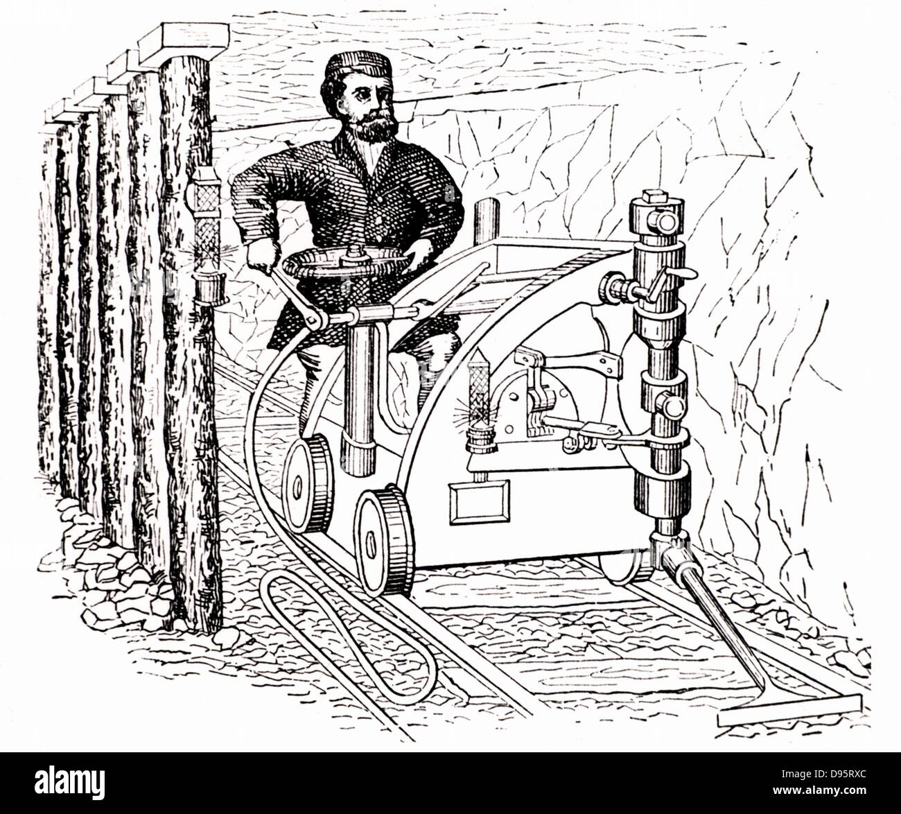 Coal cutting machine on rails, powered by compressed air produced by a steam engine at the pithead. From 'The - Stock Image