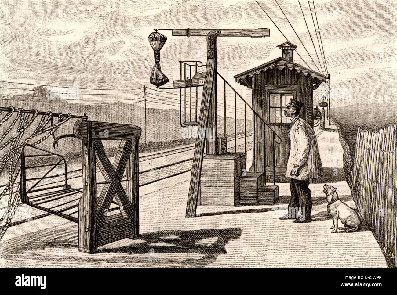 French postal service. Mail train approaching a railway station platform fitted with apparatus for catching sacks - Stock Image