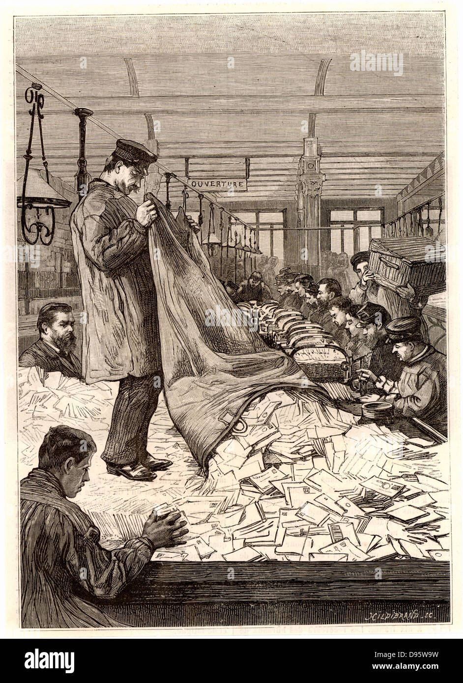 French postal service. Sacks of letters being emptied out in the sorting office at the main Post Office, rue du Stock Photo