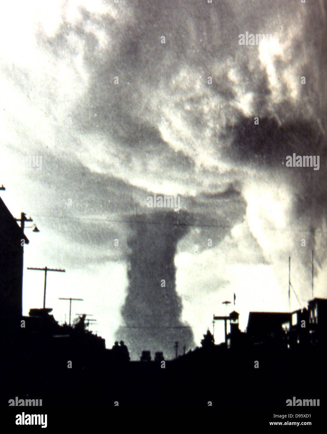 Tornado striking a town in the Mid-West of the USA, 1930s. - Stock Image