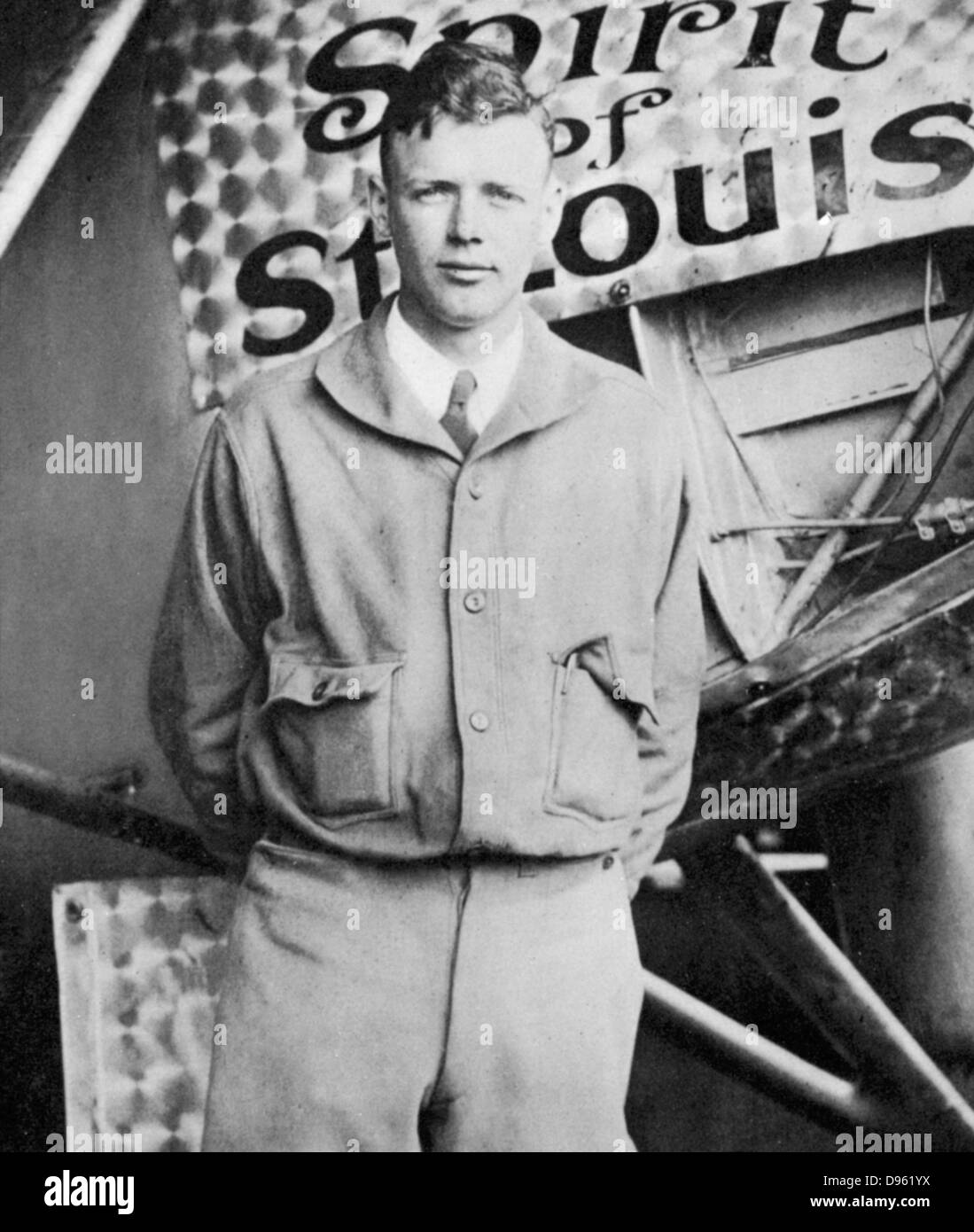 Charles Lindbergh (1902-1974) in his flying kit standing by 'Spirit of St Louis', the plane in which he - Stock Image