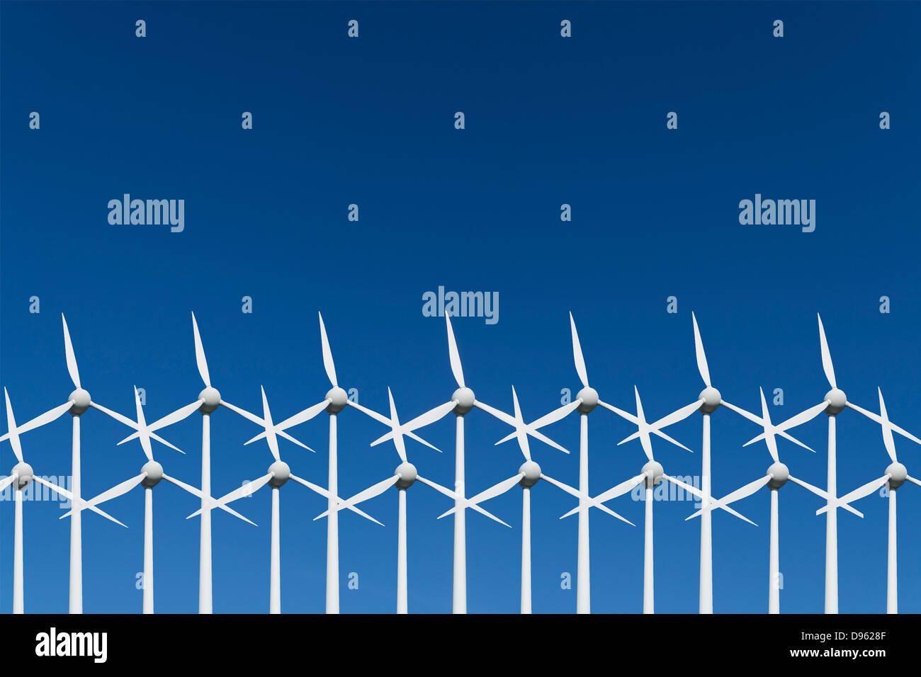 Germany, Bavaria, Wind turbine against blue sky - Stock Image