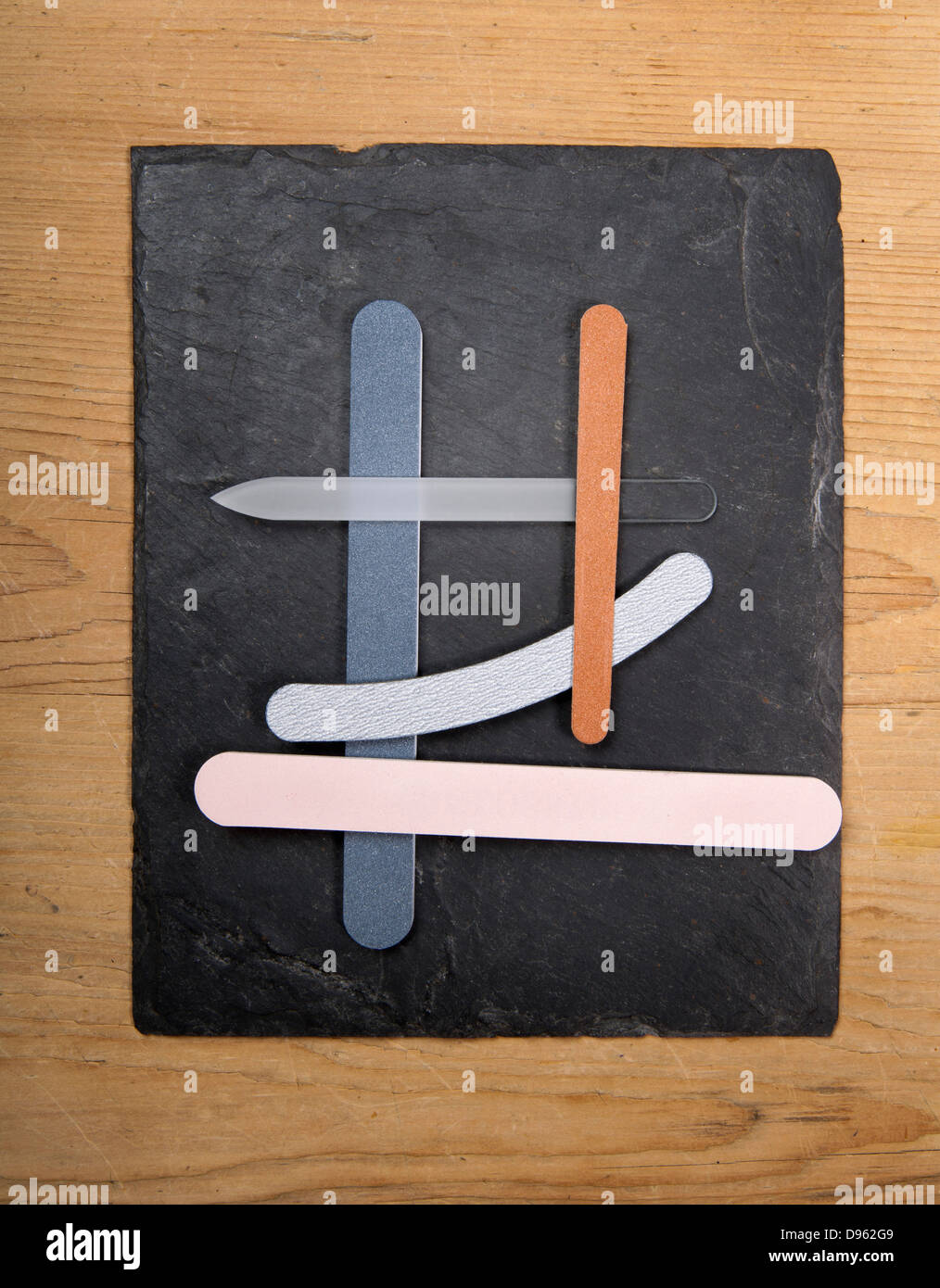 Nail file, emery boards on slate board, close up - Stock Image
