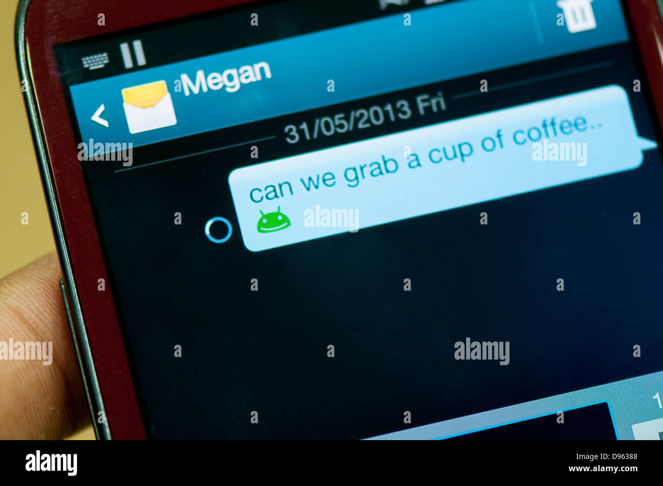 Sending text message screen on cell phone - Stock Image