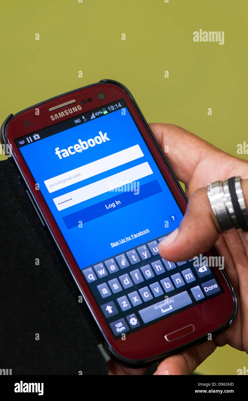 Facebook login screen on mobile phone Stock Photo