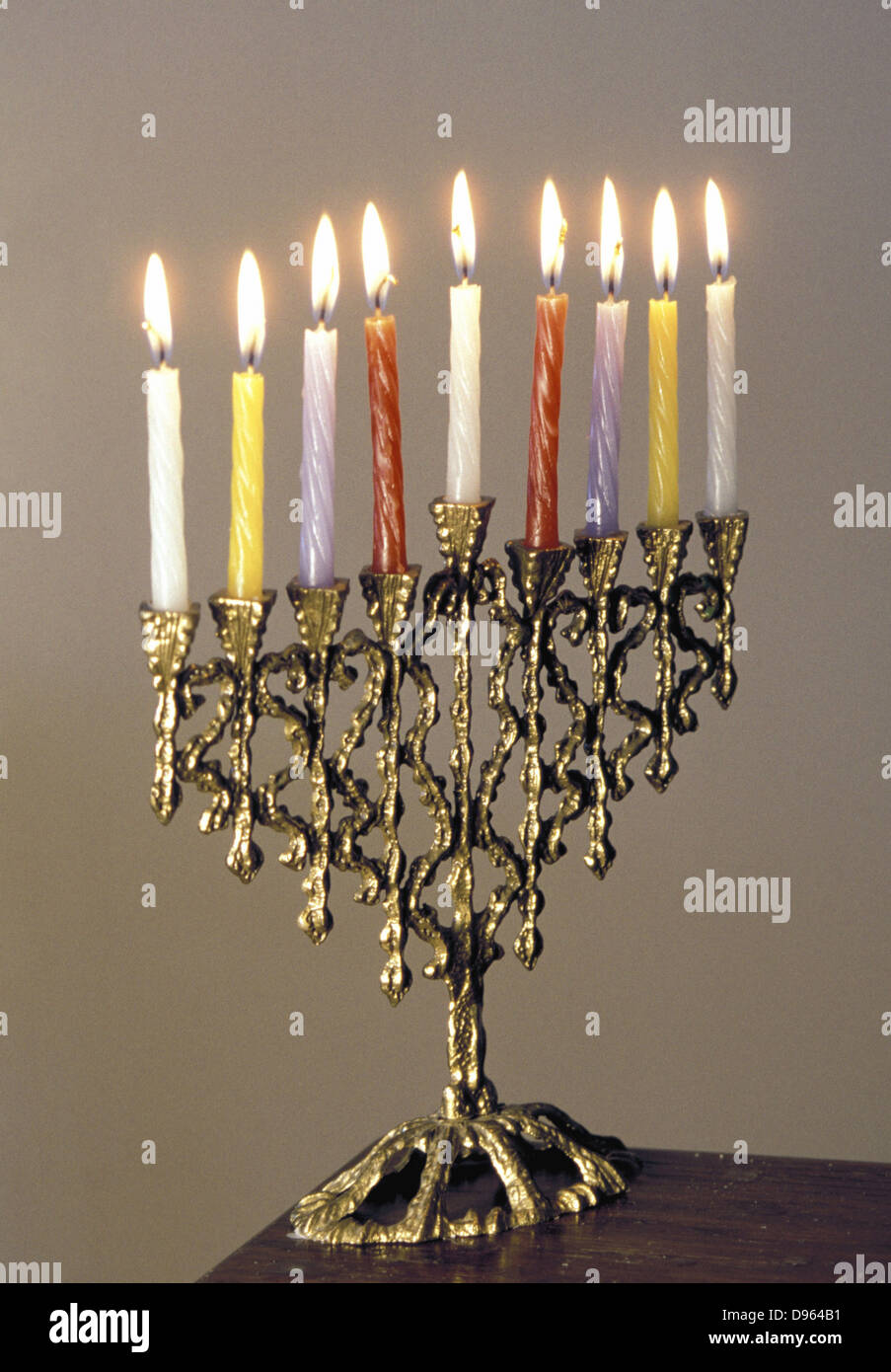9-branched candelabra used in Judaism at Hannukah . - Stock Image