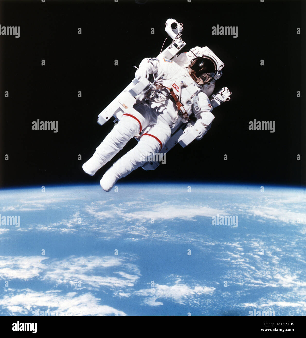 US Astronaut Bruce McCandless on Mission 41-B on extravehicular space movement using first nitrogen-propelled, hand - Stock Image