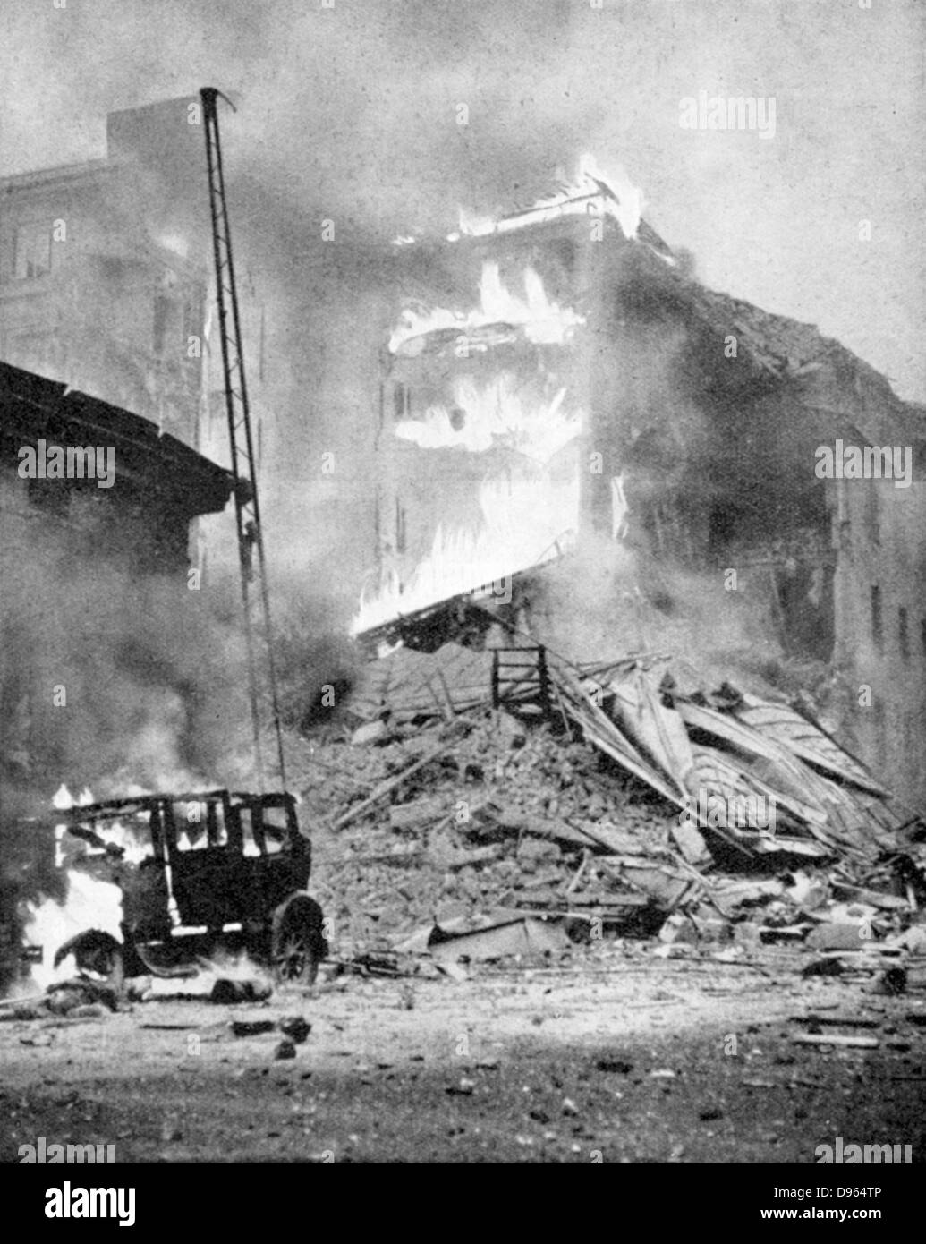 World War 2: Finland. Bombing of Helsinki by the Russians.  Block of flats in flames after a direct hit. - Stock Image