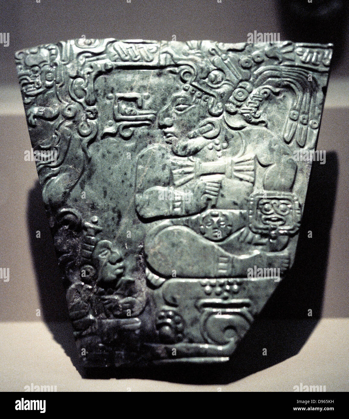 Jade plaque showing Mayan king seated, 400-800. - Stock Image