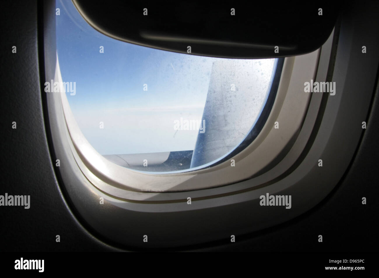 a view of the sky through a British Airways Boeing 777 aircraft window Stock Photo