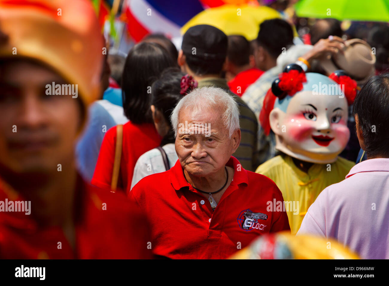 Man with a gun on his shirt during the Chinese New Year Celebrations in Bangkok's Chinatown - Stock Image