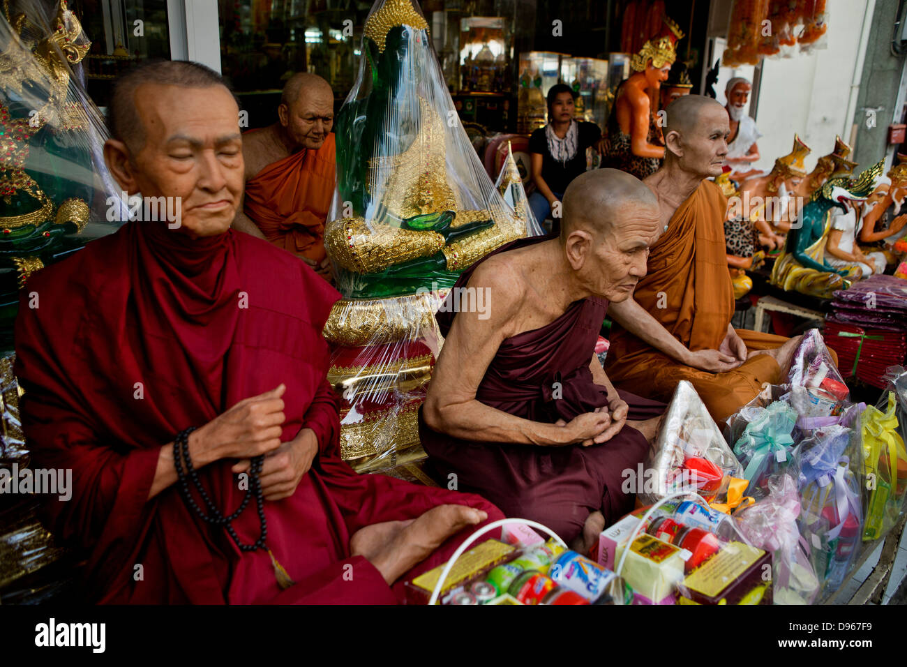 Waxwork statues of revered Buddhist figures for sale, Bangkok, Thailand - Stock Image